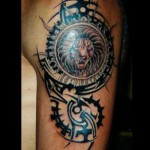 bras tatouage tribal motif lion